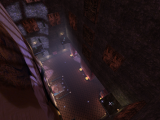 Looking down into the castle - images of Horatio Bear on the floor and walls. Platforms with teleports in the corners.
